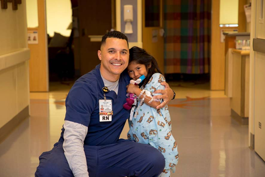 46_UC_DavisChildrensHospital_PICU_nurse_and_little_girl_in_hall