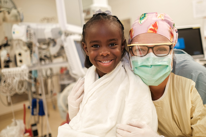 44_ChildrensMinnesota_smilingwithnurse
